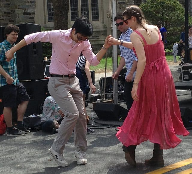 A couple dancing at Communiversity in 2013. Bands will perform on six stages for the 2015 celebration.