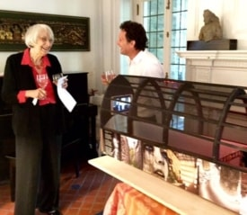 Ingrid Reed and Peter Abrams chat next to a model of the Design at Dohm Alley.