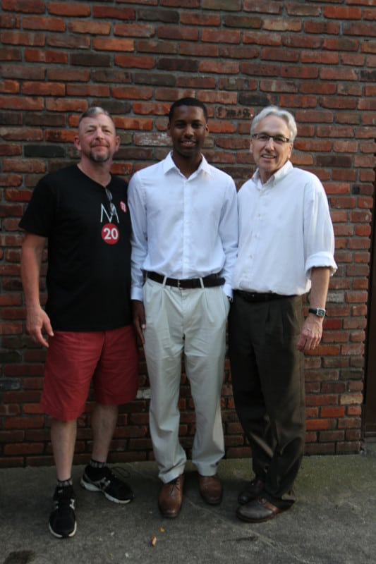Zachary Logan (c) with Anchor House Foundation President John Murray (l) and Tom Pryor, president of the Anchor House Board of Directors.